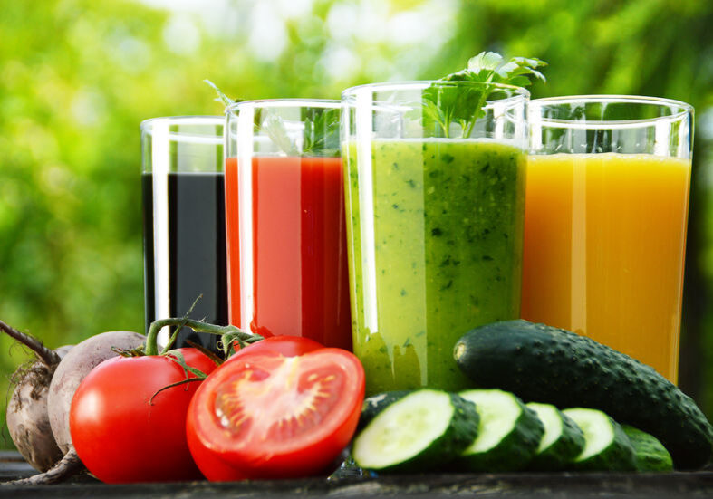 30405438 - glasses with fresh vegetable juices in the garden  detox diet